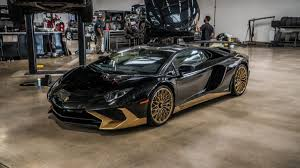 all black lamborghini this black and gold lamborghini aventador sv coupe is one of the