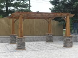 Outdoor Living Patio Ideas by Wood Pergola With Stone Pillars On A Back Patio Wood Pergolas
