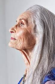 70 year old ladies with short grey hair just love the lines on her face all her travels senior women