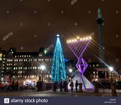 tree of menorah london uk menorah and christmas tree on trafalgar square stock photo