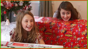 girls opening presents on christmas day happy new years