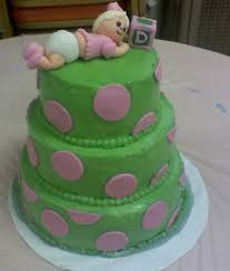 green baby shower cake with pink dots and baby cake