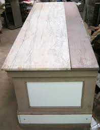 antique store counter kitchen island marble top milk glass panels