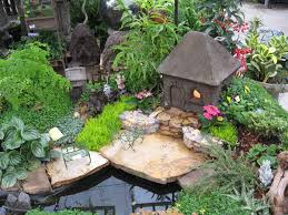 luxurious fairy garden decorations with simple green chair closed