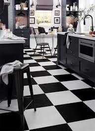 white kitchen cabinets black tile floor kitchen flooring trends for 2020 flooring america