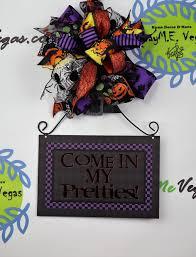 halloween door hanger u2022 wreaths garland centerpieces door