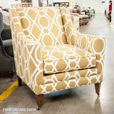 beige tufted leather accent chair design with varnished wood arm