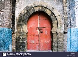 Moorish Architecture Red Metal Door In A Stone Arch Moorish Architecture Morocco