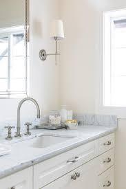 satin nickel bathroom sconces and faucet transitional bathroom
