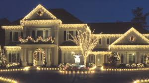 How To Decorate Outdoor Trees With Lights - outdoor holiday decorations u2013 tree lighting u2013 monkeysee videos