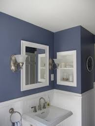 blue wall paint mirror with white wooden frame granite coutnetop