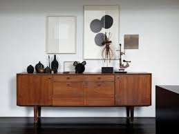 white flooring unit applied in mid century cabinets made with