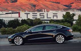 in pivotal moment tesla unveils its first mass market sedan the