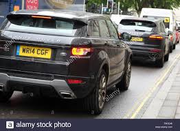 land rover black modern black 4x4 vehicles suv in town traffic land rover range