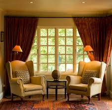 drapes framing a wall to wall window interior design window