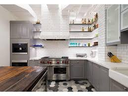 traditional glass shading diagonal tile backsplash stainless steel