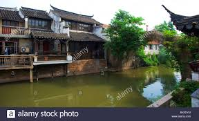 traditional two story houses along the river at dusk xitang stock