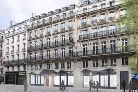 un siege social inn transforme un immeuble de bureaux en hôtel 5