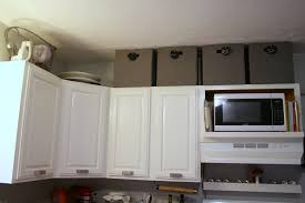 how to decorate on top of kitchen cabinets appliance baskets on top of kitchen cabinets above cabinet