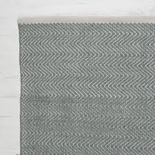 floor white baseboard with grey rug plus wooden flooring for