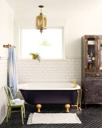 clawfoot tub bathroom ideas a 1920s claw foot tub is front and center against simple subway