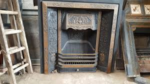 black ornate cast iron fireplace with gold surround watling