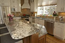 granite countertop white cabinets with crown molding motawi tile