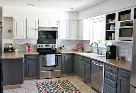 cream kitchen with black appliances rustic brown ceramic floor