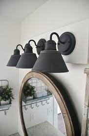 excellent black vanity light fixtures above a large round mirror