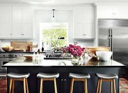 white kitchen with black island these 7 stunning kitchens the for black cabinets mydomaine