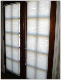 roman shade on french door with stained glass french doors