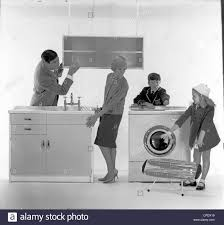 1960s family members in a photographic studio admire the new