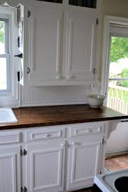kitchens with stained wooden baseboards we used chair rail and