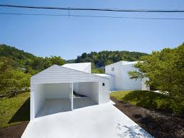 home roof has circular cut outs to emulate tree canopies