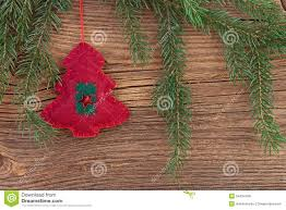 traditional christmas decoration with fir branch on wooden