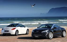 peugeot rcz 2015 two peugeot rcz on the beach