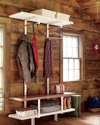 white iron coat rack plus wood seating bench and shabby chic