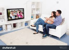 happy young couple livingroom sitting on stock photo 165214892