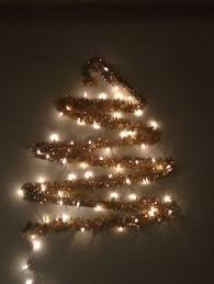 lights on wall in the shape of a tree and decorated for room