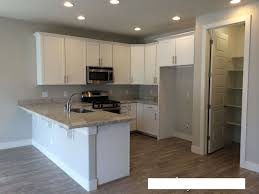 Backsplash With White Kitchen Cabinets Granite Countertop Painted White Cabinets Long Subway Tile