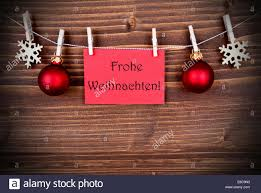 banner with the german words frohe weihnachten which means merry