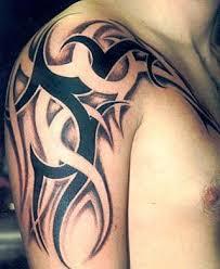 grey and black tribal designs on shoulder for