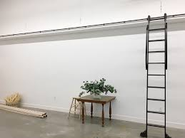 wall of shelves inspiration for the studio shelving little green notebook