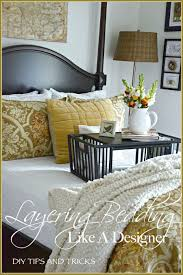 interior design tips and tricks layering bedding like a designer tips and tricks stylish beds