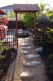 contemporary garden gate landscape asian with tree stepping stone tree