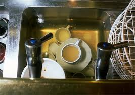 Dirty Cups In Kitchen Sink Stock Photos Page   Masterfile - Dirty kitchen sink