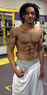 this shirtless tattooed hippy is the of a rapper