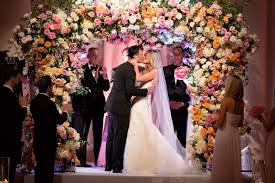 wedding arches meaning colorful ceremony ballroom reception at the breakers
