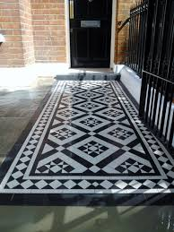 victorian garden walls black and white victorian mosaic tile path red brick garden wall