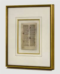 monastic breviary page from a monastic breviary floating in a gold frame surrounded